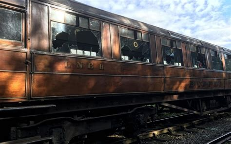 Historic Yorkshire Moors rail carriages seen in Downton