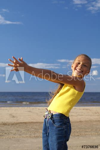"""""""Preteen girl on a beach"""" Stock photo and royalty-free"""