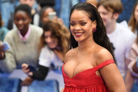 Rihanna parades in bejewelled bikini to show off ample