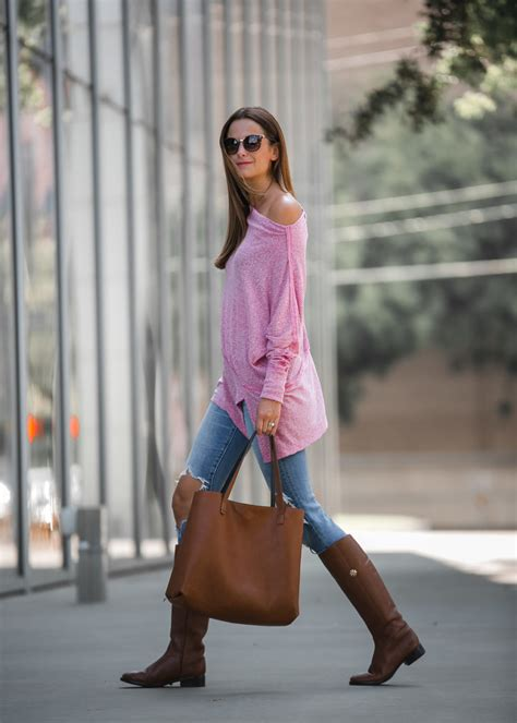 The Miller Affect wearing Levi's jeans with Tory Burch