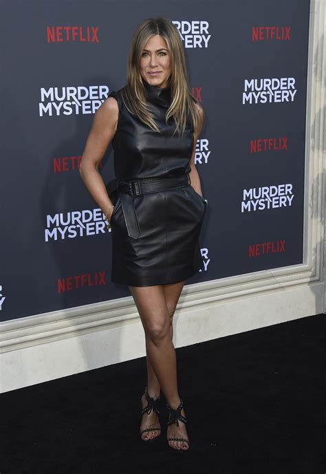 Aniston to Sandler before kissing scenes: 'Oil up the
